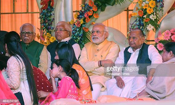 Prime minister Narendera Modi RJD chief Lalu Prasad Yadav SP national president Mulayam Singh Yadav and Uttar Pradesh's Governor Ram Naik during the...