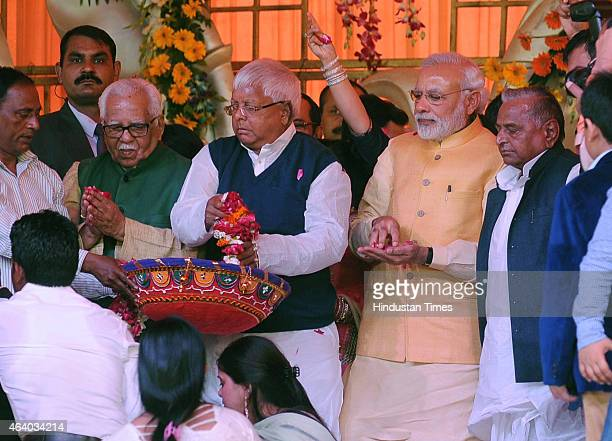 Prime minister Narendera Modi RJD chief Lalu Prasad Yadav SP national president Mulayam Singh Yadav and UP Governor Ram Naik showering flower petals...