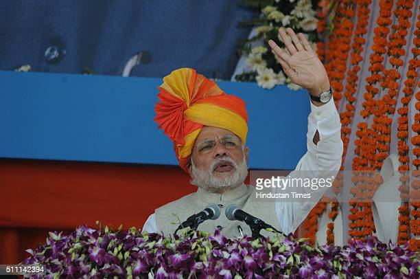Prime Minister Narendra Modi addresses a massive crowd of farmers during the launch of Prime Minister Crop Insurance Scheme at Sherpur village in...