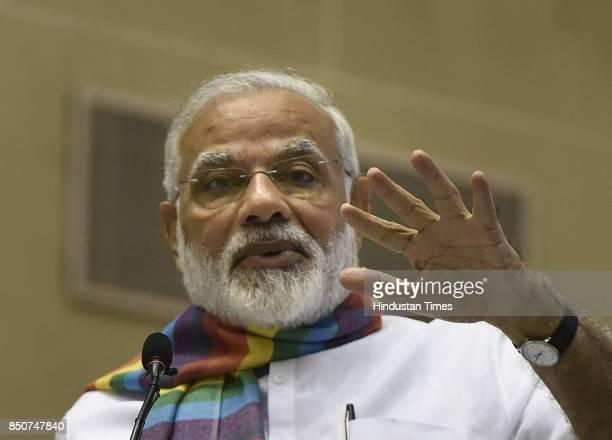 Prime Minister Narendra Modi addresses the gathering at Sahkar Sammelan on the occasion of birth centenary of Laxmanrao Inamdar on September 21 2017...