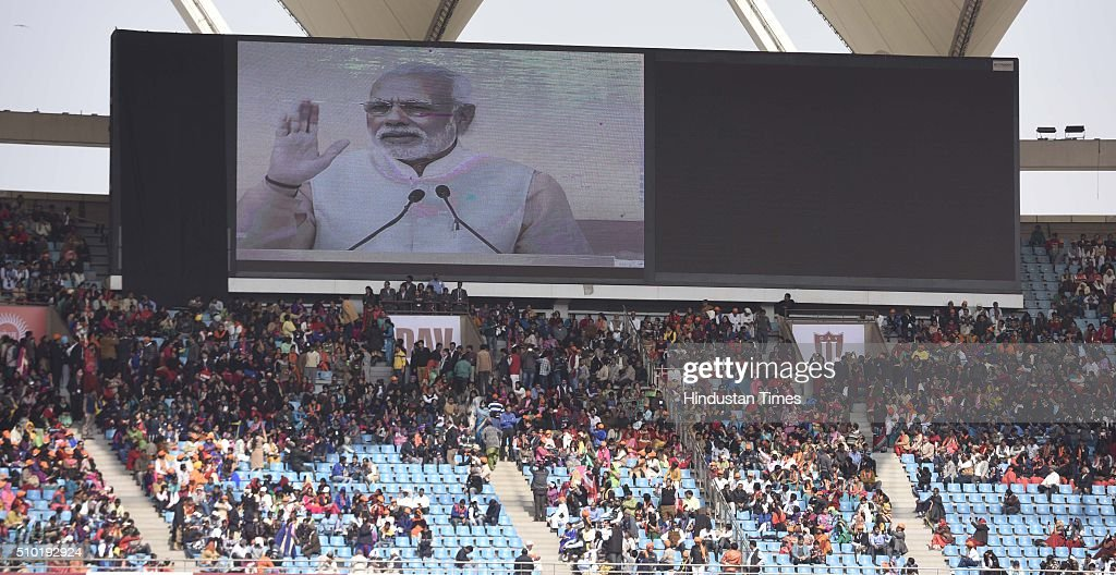 Prime Minister Narendra Modi addresses the student and teachers during a function to celebrate the birth anniversary of Swami Dayanand Saraswati, the founder of the social reform movement Arya Samaj at Jawahar Lal Nehru stadium on February 14, 2016 in New Delhi, India. Rejecting opposition criticism over the state of the economy, Modi said as the world was grappling with financial crisis, India alone was 'progressing at a rapid pace' because of the policies of his government.