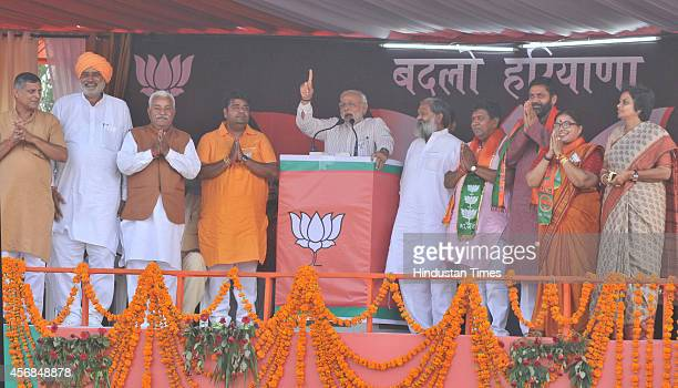 Prime Minister Narendra Modi addressing an election campaign rally on October 8 2014 in Jagadhri India Haryana Legislative Assembly election will be...
