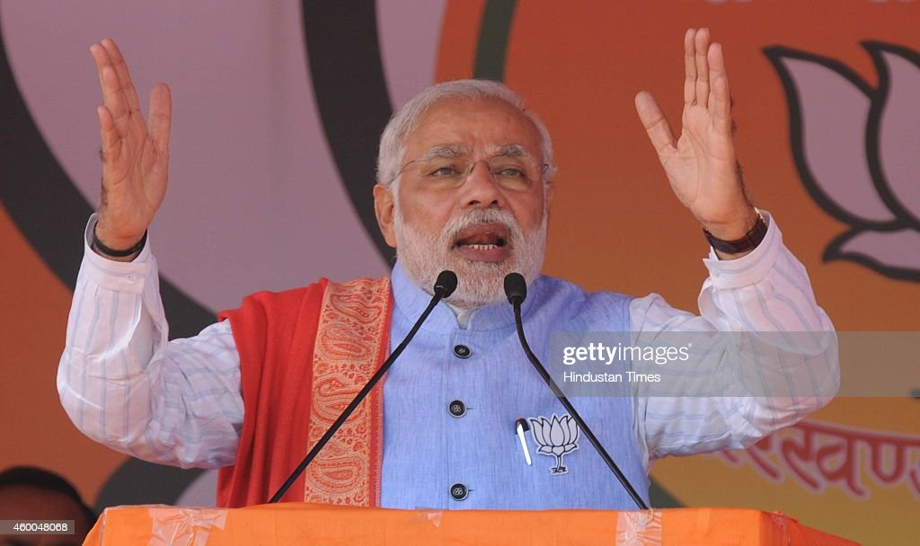 Prime Minister <a gi-track='captionPersonalityLinkClicked' href=/galleries/search?phrase=Narendra+Modi&family=editorial&specificpeople=822611 ng-click='$event.stopPropagation()'>Narendra Modi</a> addressing an election rally at Gandhi Maidan on December 6, 2014 in Hazaribagh, India. Modi said, 'Jharkhand is not an ordinary state. It can become the pride of India's economic development. If people of Jharkhand had not voted for BJP in large numbers, we would not have formed a majority government at Centre.'