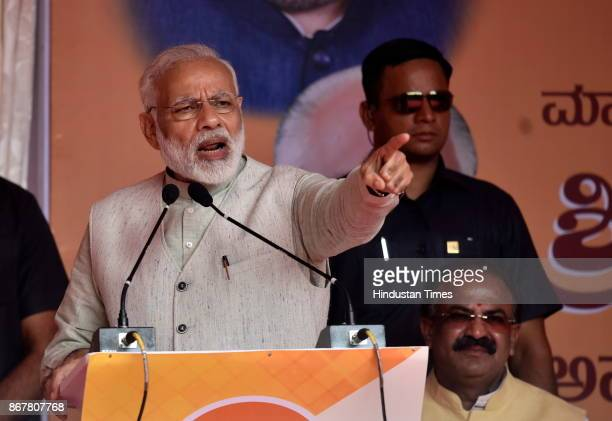 Prime Minister Narendra Modi addressing the BJP party workers during a public meeting for the launch of various programme outside HAL airport on...