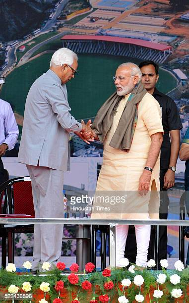 Prime Minister Narendra Modi along with JK Governor NN Vohra during a public rally after inaugurating a sports complex and a superspecialty hospital...