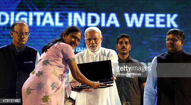 Prime Minister Narendra Modi along with Union Finance Minister Arun Jaitley and Union IT minister Ravi Shankar Prasad during the launch of Digital...