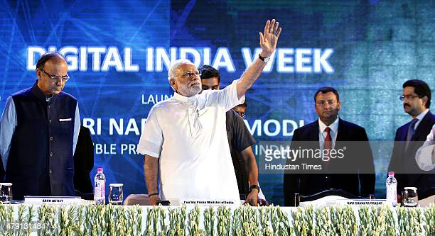 Prime Minister Narendra Modi along with Union Finance Minister Arun Jaitley during the launch of Digital India Week at IGI Stadium on July 1 2015 in...