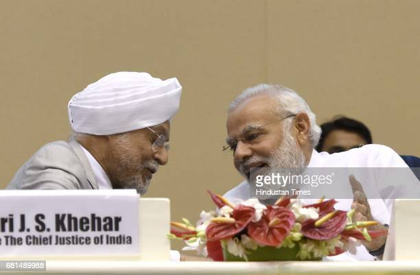 Prime Minister Narendra Modi and Chief Justice of India JS Khehar during the moving towards digital and paperless court programme which aims at...