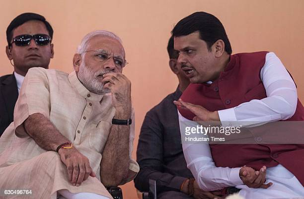 Prime Minister Narendra Modi and Maharashtra Chief Minister Devendra Fadnavis at the foundation stone laying ceremony of the two metro corridors and...