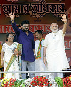 Prime Minister Narendra Modi and MP Union Minister of state Babul Supriyo during a public rally for election campaign at Asansol on April 7 2016 in...