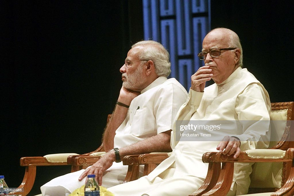 Prime Minister <a gi-track='captionPersonalityLinkClicked' href=/galleries/search?phrase=Narendra+Modi&family=editorial&specificpeople=822611 ng-click='$event.stopPropagation()'>Narendra Modi</a> and senior BJP leader L.K. Advani during the BJP parliamentary board meeting, on April 21, 2015 in New Delhi, India. PM Modi has called a meeting of Bharatiya Janata Party parliamentary board ahead of the session and is likely to discuss issues related to the land day. During a Budget Session on Monday, Congress Vice-President Rahul Gandhi said the government was 'ignoring' the farming community and favouring the industrialists and rich people.