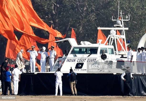 Prime Minister Narendra Modi arrives at Girgaum Chowpatty to lay the foundation of the Shiv Smarak in the Arabian Sea on December 24 2016 in Mumbai...