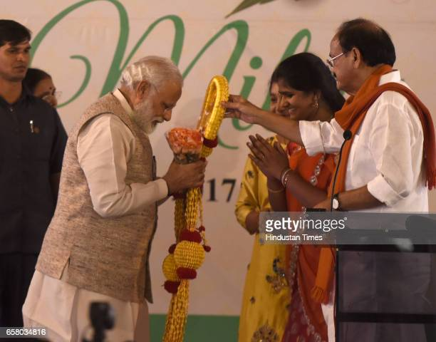 Prime Minister Narendra Modi being honoured in traditional way by Union Minister Venkaiah Naidu and others on the occasion of 'Ugadi' according to...