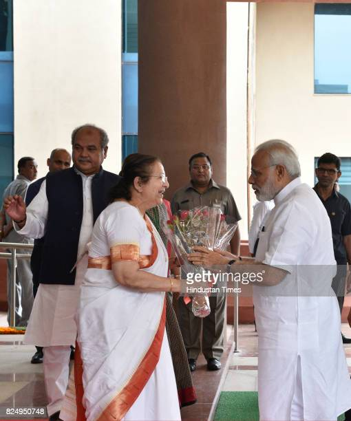 Prime Minister Narendra Modi being received by Lok Sabha Speaker Sumitra Mahajan at the inauguration of the Parliament House Annexe Extension...