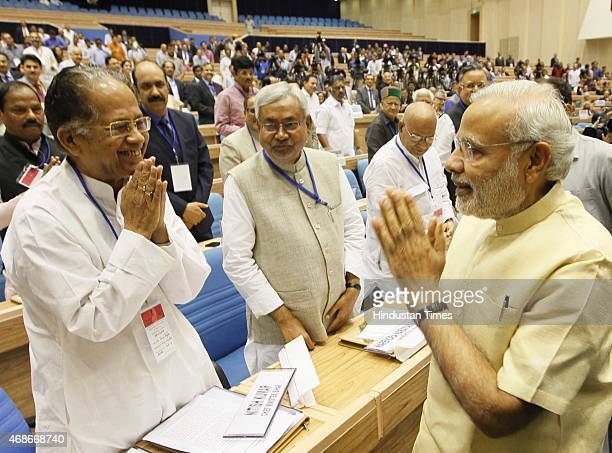 Prime Minister Narendra Modi Chief Minister of Assam Tarun Gogoi and Chief Minister of Bihar Nitish Kumar during the joint conference of the Chief...