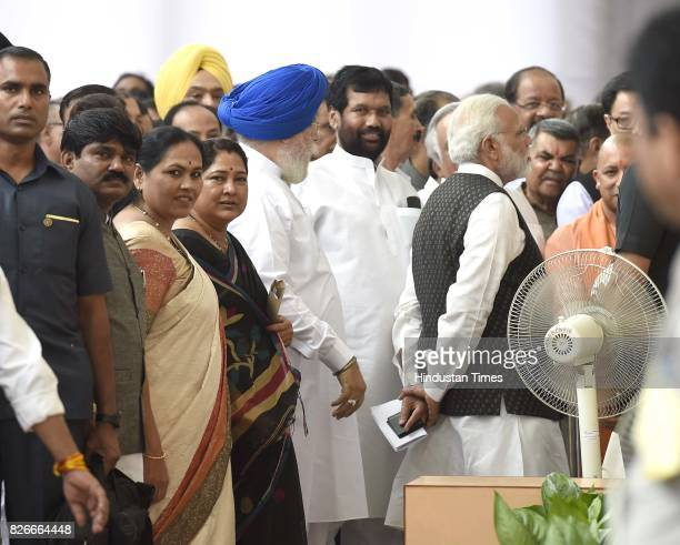 Prime Minister Narendra Modi Chief Minister of Uttar Pradesh Yogi Adityanath Union Minister Ram Vilas Paswan and other leaders in queue for casting...