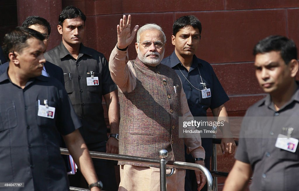 Prime Minister <a gi-track='captionPersonalityLinkClicked' href=/galleries/search?phrase=Narendra+Modi&family=editorial&specificpeople=822611 ng-click='$event.stopPropagation()'>Narendra Modi</a> coming out his PM office at South Block after taking charge on May 27, 2014 in New Delhi, India. <a gi-track='captionPersonalityLinkClicked' href=/galleries/search?phrase=Narendra+Modi&family=editorial&specificpeople=822611 ng-click='$event.stopPropagation()'>Narendra Modi</a> was sworn in as prime minister May 26 holding the strongest mandate for 30 years, promising to forge a 'strong and inclusive' country.