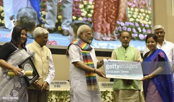 Prime Minister Narendra Modi distributes the awards to cooperative societies at the birth centenary celebration of Laxman Rao Inamdar and Sahakar...
