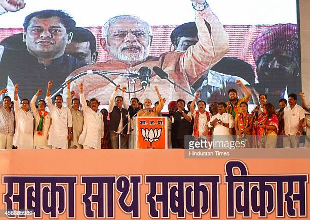Prime Minister Narendra Modi during the 2014 State Assembly Elections campaign rally for Bharatiya Janata Party at Mahalaxmi on October 4 2014 in...