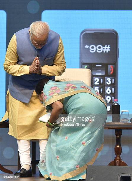 Prime Minister Narendra Modi felicitates the first set of 7229 winners of Digi Dhan Lucky Draw under which daily reward of Rs 1000 will be given to...