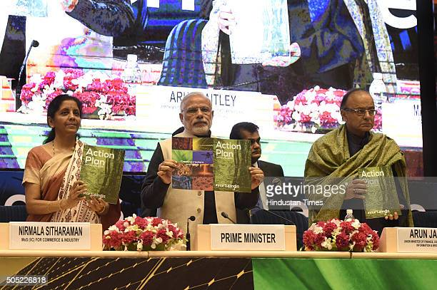 Prime Minister Narendra Modi Finance Minister Arun Jaitley and Minister of States for Independent Charge Nirmala Sitharaman releasing the Action Plan...