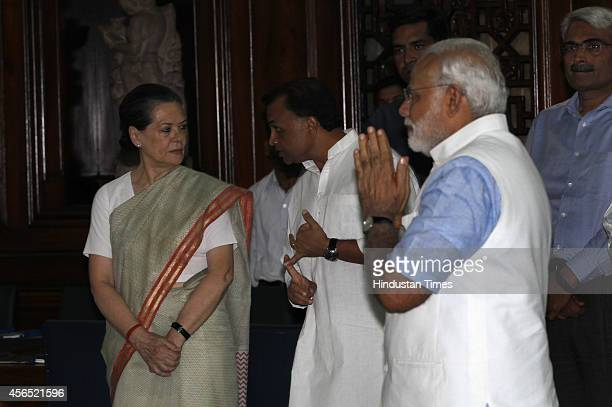 Prime Minister Narendra Modi greets Congress president Sonia Gandhi during an event to pay tribute to Mahatma Gandhi and Lal Bahadur Shastri on their...