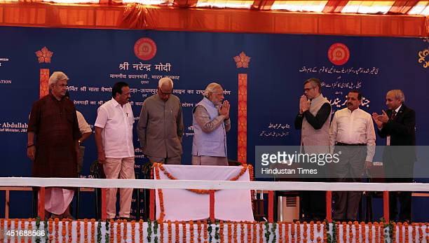 Prime Minister Narendra Modi greets Jammu and Kashmir Chief Minister Omar Abdullah after the inauguration of the KatraUdhampur rail link on July 4...