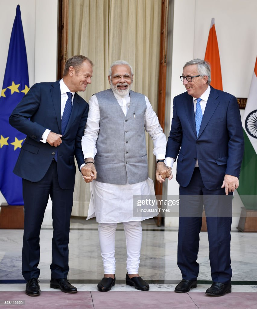 Prime Minister Narendra Modi holds hands with Donald Tusk (L), President of the European Council, and European Commission President Jean-Claude Juncker prior to a meeting on October 6, 2017 in New Delhi, India.