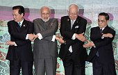 Prime Minister Narendra Modi joins hands with Vietnam's Prime Minister Nguyen Tan Dung Malaysia's Prime Minister Najib Razak and Laos Prime Minister...