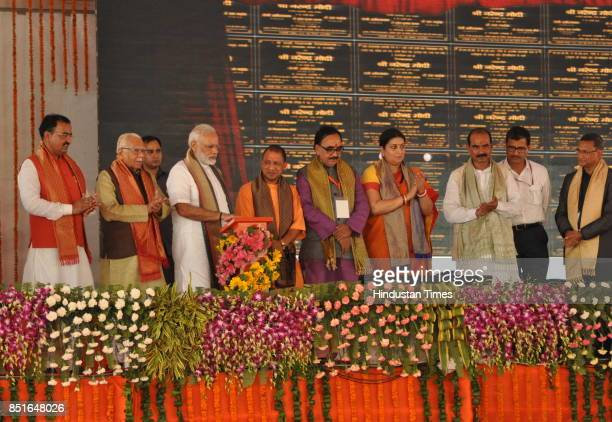 Prime Minister Narendra Modi launches several projects by pushing button as UP CM Yogi Adityanath Union Minister Smriti Irani BJP UP President...