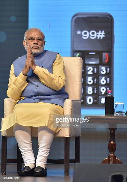 Prime Minister Narendra Modi looks on before launching a digital payment app linked with a nationwide biometric database during the Digi Dhan fair on...
