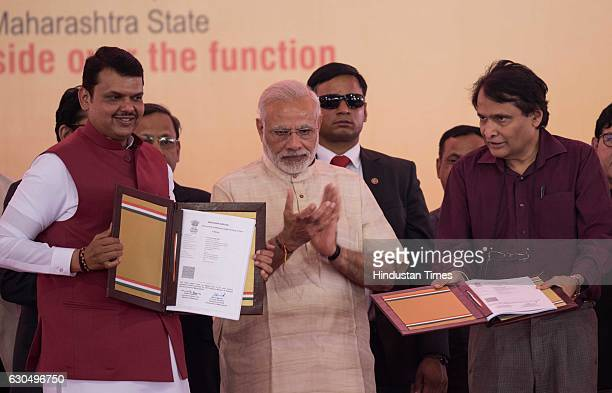 Prime Minister Narendra Modi Maharashtra Chief Minister Devendra Fadnavis and Railway Minister Suresh Prabhu at the foundation stone laying ceremony...