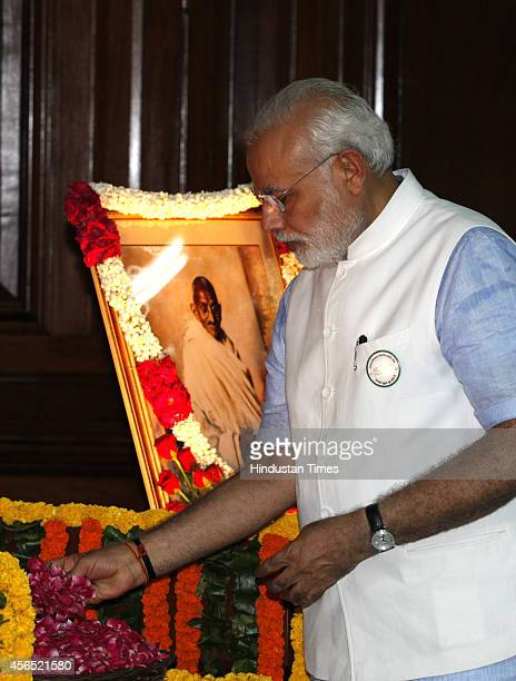 Prime Minister Narendra Modi pays tribute to Mahatma Gandhi and Lal Bahadur Shastri on their birth anniversary at Parliament House on October 2 2014...
