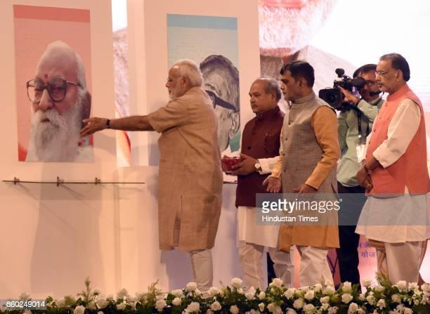 Prime Minister Narendra Modi pays tributes to Nanaji Deshmukh Jaiprakash Narayan with Union Minister of the State GovernmentAgriculture Farmers...