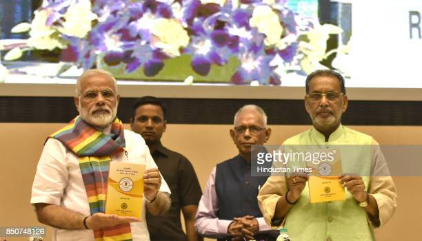 Prime Minister Narendra Modi releases the book on Indian Cooperative Movement at the birth centenary celebration of Laxman Rao Inamdar and Sahakar...