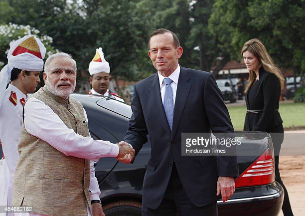 Prime Minister Narendra Modi shakes hand with his Australian counterpart Tony Abbott during a ceremonial reception at Rashtrapati Bhavan on September...