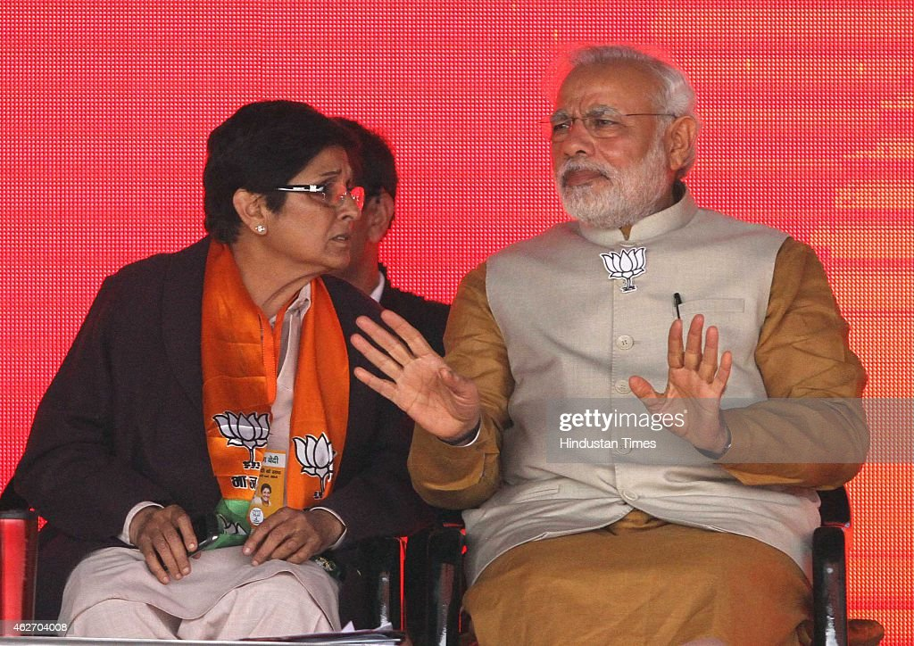 Prime Minister <a gi-track='captionPersonalityLinkClicked' href=/galleries/search?phrase=Narendra+Modi&family=editorial&specificpeople=822611 ng-click='$event.stopPropagation()'>Narendra Modi</a> speaks with Bharatiya Janata Party's (BJP) Delhi chief ministerial candidate <a gi-track='captionPersonalityLinkClicked' href=/galleries/search?phrase=Kiran+Bedi&family=editorial&specificpeople=2886102 ng-click='$event.stopPropagation()'>Kiran Bedi</a> during a public rally for the upcoming Delhi Assembly Elections, on February 3, 2015 in New Delhi, India. Modi launches an all-out frontal attack on AAP, says those who knew who have accounts in Swiss banks, who kept such names in their pockets, are now saying we don't know who gave us money. He promises abundant power supply in the national capital.