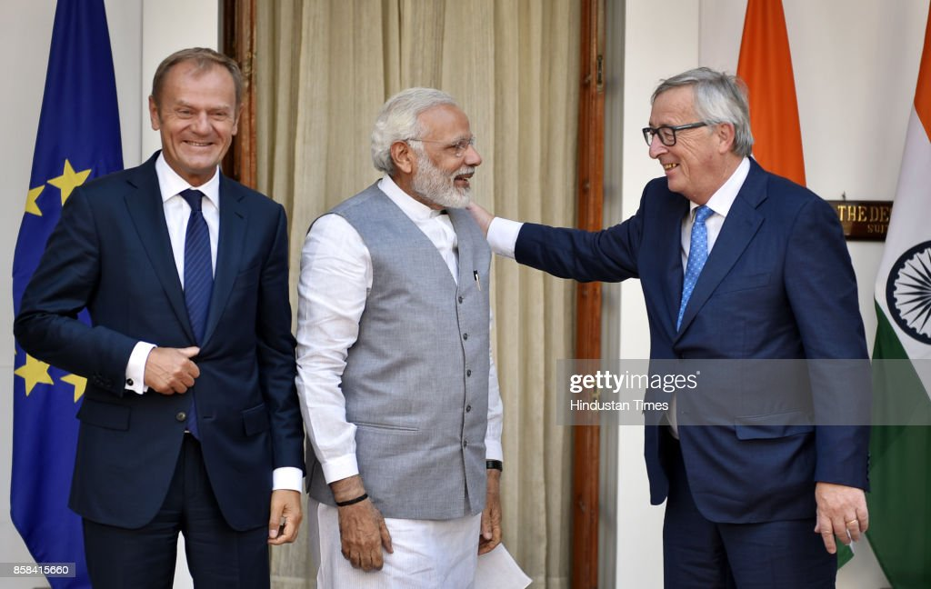 Prime Minister Narendra Modi (C) stands with Donald Tusk (L), President of the European Council, and European Commission President Jean-Claude Juncker prior to a meeting on October 6, 2017 in New Delhi, India.