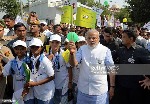 Prime Minister Narendra Modi takes part in walkathon as part of the nationwide campaign 'Swachh Bharat Mission' after its launch in New Delhi
