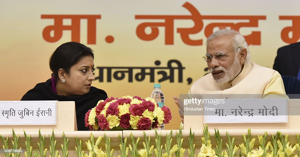 Prime Minister Narendra Modi talking with HRD Minister Smriti Irani during the Akhil Bharatiya Prachaarya Sammelan organized by the Vidya Bharati Akhil Bharatiya Shiksha Sansthan at Vigyan Bhawan on February 12, 2016 in New Delhi, India. The Prime Minister addressed principals of about 1,300 senior secondary schools on the key role of principal in social and academic scenario.