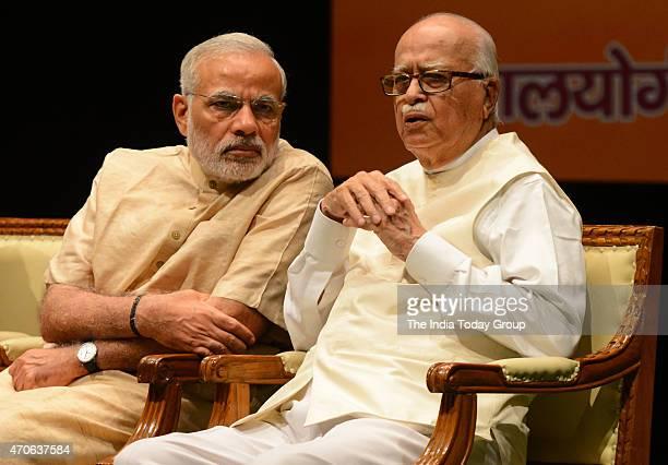 Prime Minister Narendra Modi talking with BJP veteran LK Advani during 'Garib Kalyan Yojana' a workshop about the various pro poor policies initiated...