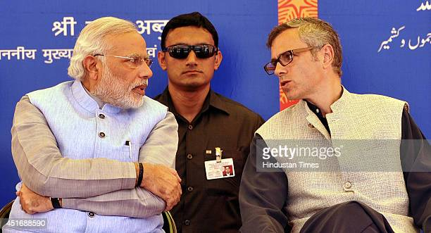 Prime Minister Narendra Modi talks with Jammu and Kashmir Chief Minister Omar Abdullah after the inauguration of the KatraUdhampur rail link on July...