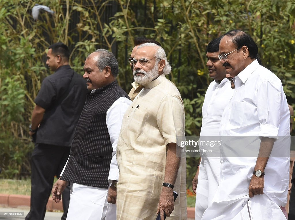 Prime Minister Narendra Modi(C) Union Parliamentary Affairs Minister M Venkaiah Naidu ( L) Union Minister of Mines, Steel, Labour and Employment Narendra Singh Tomar ( R) walks with senior leaders Leave after attending BJP parliamentary Board Meeting at Parliament Library on May 3, 2016 in New Delhi, India. With the BJP mounting an offensive against Congress vice-president on the AgustaWestland VVIP chopper bribery case, Rahul Gandhi on Wednesday said he is happy to be targeted.