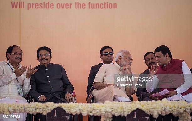 Prime Minister Narendra Modi Urban Development Minister M Venkaiah Naidu and Maharashtra Chief Minister Devendra Fadnavis at the foundation stone...
