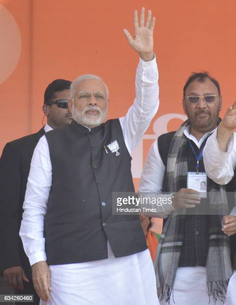 Prime Minister Narendra Modi waves his hand to greet supporters during a BJP election campaign rally on February 8 2017 in Ghaziabad India Prime...