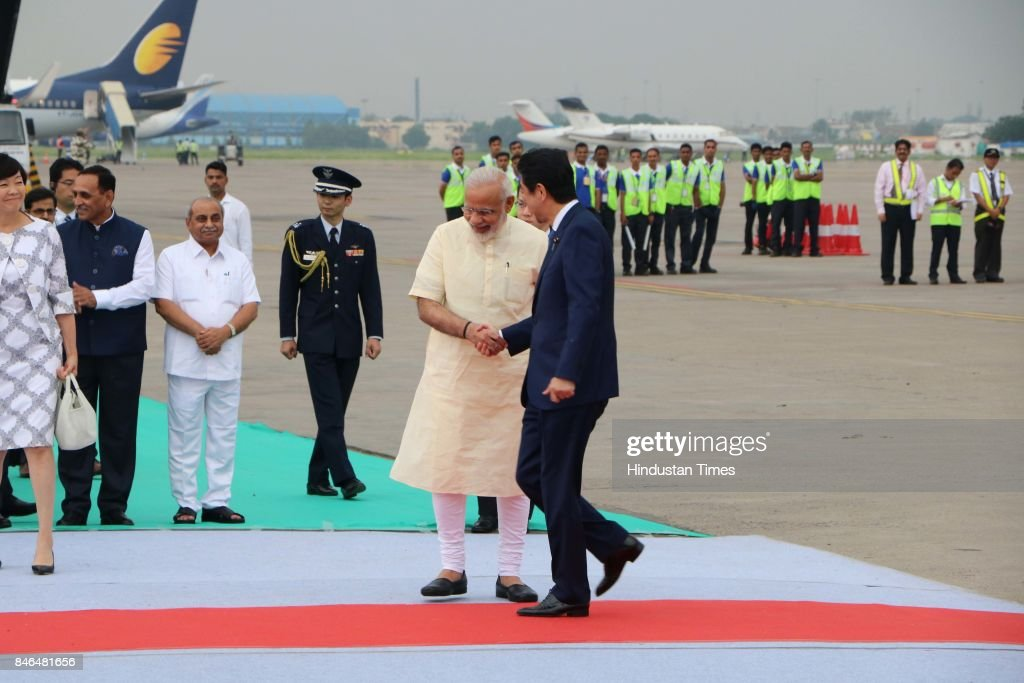 Prime Minister Narendra Modi welcomes Japanese Prime Minister Shinzo Abe upon his arrival at airport, on September 13, 2017 in Ahmadabad, India. Japanese Prime Minister Shinzo Abe arrived in Ahmedabad on Wednesday at the start of a two-day visit to host Prime Minister Narendra Modi's home state of Gujarat, with the two leaders aiming to further shore up economic and strategic ties between their nations.