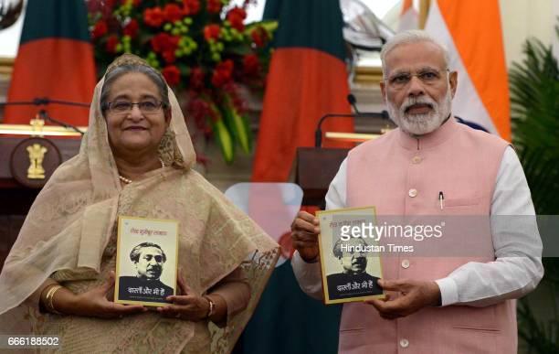 Prime Minister Narendra Modi with Bangladeshi Prime Minister Sheikh Hasina releases the Hindi translation of Bangabandhu Sheikh Mujibur Rahman's...