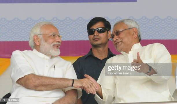 Prime Minister Narendra Modi with Bihar Chief Minister Nitish Kumar at the centenary celebrations of the Patna University on October 14 2017 in Patna...