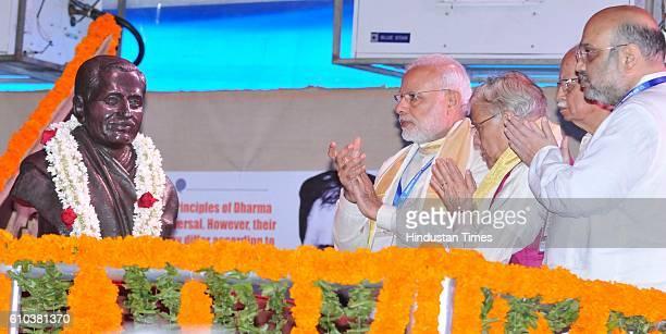 Prime Minister Narendra Modi with BJP President Amit Shah senior BJP leaders LK Advani Murali Manohar Joshi and others during the BJP public meeting...