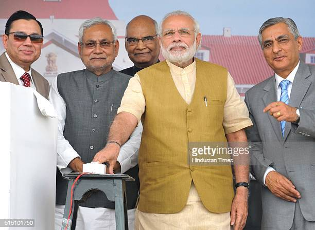 Prime Minister Narendra Modi with Chief Justice of India Justice TS Thakur and Bihar Chief Minister Nitish Kumar during the Closing Ceremony of the...